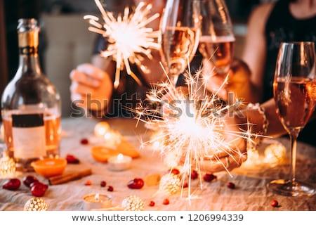 barátok · ünnepel · karácsony · iszik · bor · ünnepek - stock fotó © dolgachov