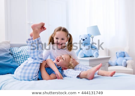 Toddler playing on the bed Stock photo © colematt