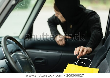 Man Stealing Bag From Car Stock photo © AndreyPopov