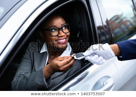 Woman Giving Car Key To Male Valet Stock photo © AndreyPopov