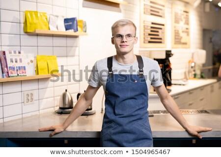 Jeune homme lunettes tablier regarder travail jeunes Photo stock © pressmaster