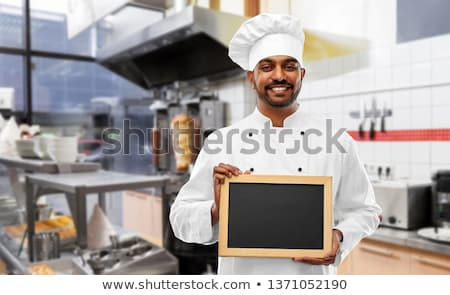 happy male indian chef in toque with chalkboard Stock photo © dolgachov