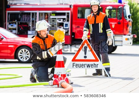 Fire fighters setting up attention sign Stock photo © Kzenon