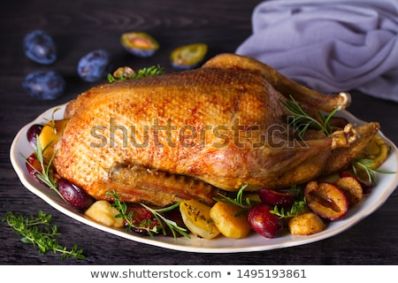 Roasted goose with herbs berries and vegetables Stock photo © olira