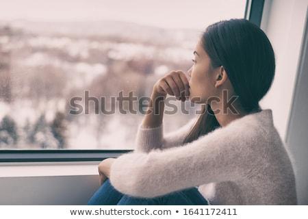 Mulher olhando distância água nuvens mão Foto stock © photography33