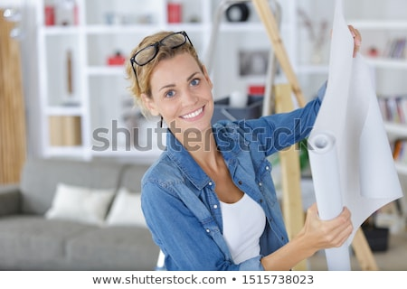 Woman wallpapering room Stock photo © photography33