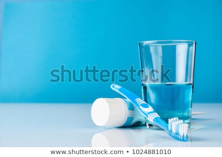 Mouthwash and toothbrush  Stock photo © Melpomene