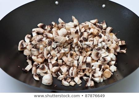 Photo of chopped mushrooms in a frying pan Stock photo © papa1266