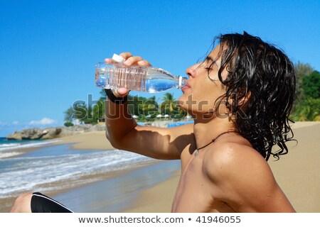 Man drinkwater fles strand landschap jonge man Stockfoto © juniart