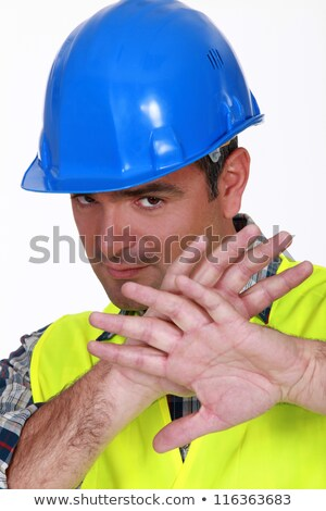 Tradesman holding his hands in front of his face Stock photo © photography33