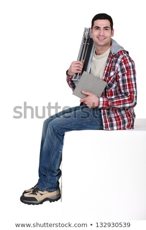 Tile fitter sitting on a block Stock photo © photography33