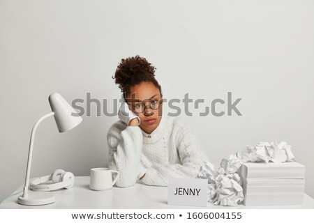 Office worker posing with a headset against a white background Stock photo © wavebreak_media