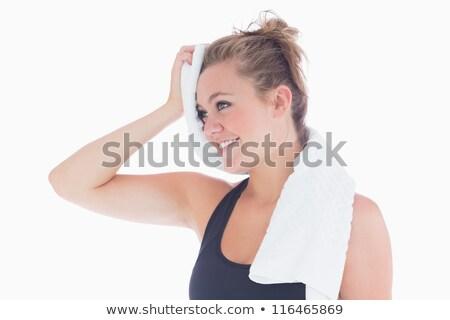 Uśmiechnięta kobieta ręcznik czoło sportowe szczęśliwy Zdjęcia stock © wavebreak_media