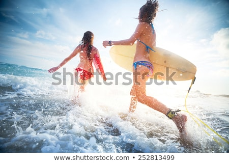 Young lady runs out of the sea stock photo © Anna_Om