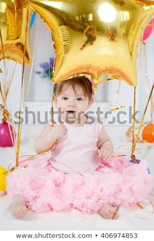 Adorable peu robe rouge séance étage Photo stock © ashumskiy