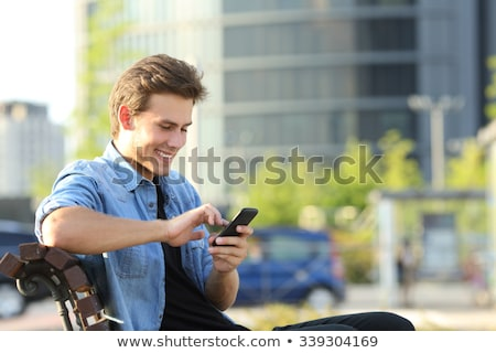 Işadamı oturma bank cep telefonu telefon Stok fotoğraf © jakubzak