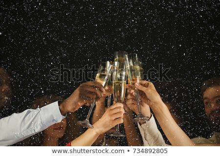 christmas greeting with champagne toast stock photo © marimorena