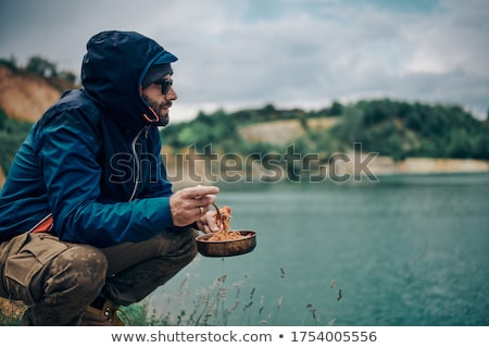 crouched young bearded man stock photo © feedough