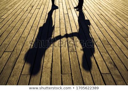 Two human shadows holding the board Stock photo © konradbak