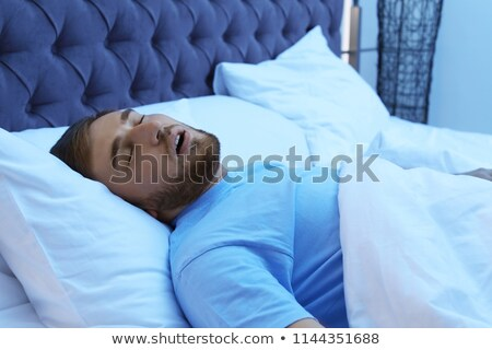 Stock photo: man with a pillow dreaming while and resting peacefully with ser