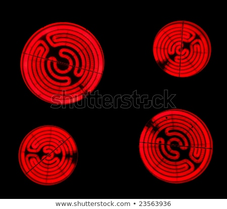 Red hot ceramic hotplate of electric cooker Stock photo © ozaiachin