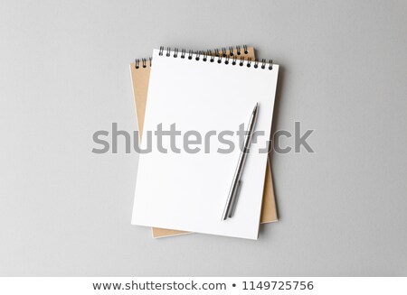 Stock photo: Closeup pen with spiral notebook