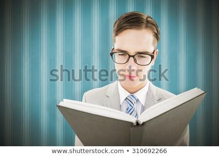 Moço leitura preto livro branco sorridente Foto stock © wavebreak_media