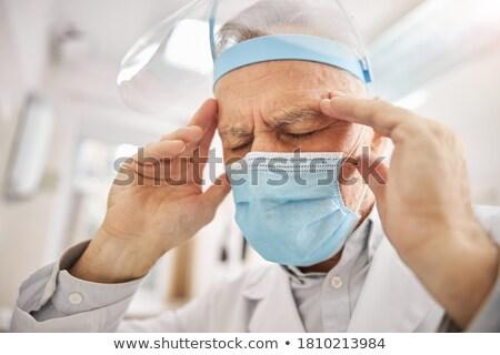 Dişçi cerrahi maske düşünme diş klinik kadın Stok fotoğraf © wavebreak_media