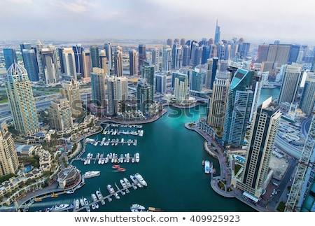 magas · Dubai · marina · felhőkarcolók · üzlet · égbolt - stock fotó © elnur