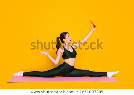 Pilates mulher móvel auto-retrato ginásio Foto stock © lunamarina