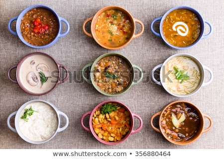 Variety of Garnished Soups in Colorful Bowls Stock photo © ozgur