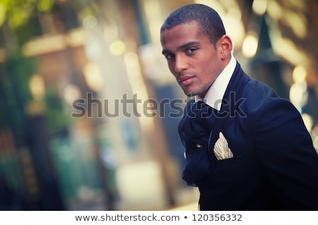 Young male model in modern suit with laptop Stock photo © zurijeta