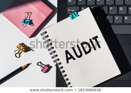 audit word and office tools on wooden table stock photo © fuzzbones0