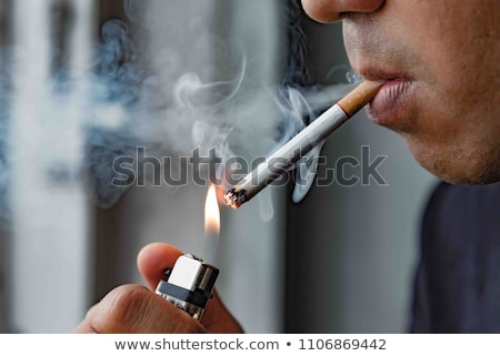 close up of young men smoking cigarettes Stock photo © dolgachov