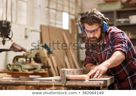 woodworker looking at his work Stock photo © Giulio_Fornasar