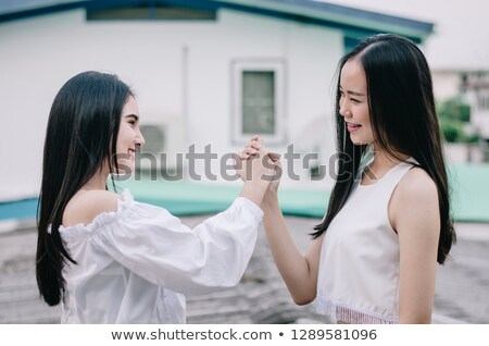 Two girls swear over white background Stock photo © deandrobot