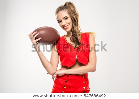 Female cheerleader with rugby ball Stock photo © LightFieldStudios