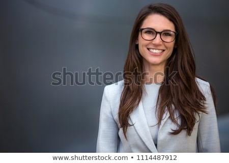 cabeza · tiro · mujer · sonriente · retrato · sonriendo · hermosa - foto stock © monkey_business