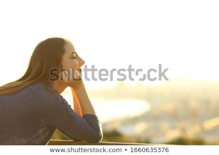 vista · lateral · mulher · jovem · varanda · em · pé - foto stock © deandrobot