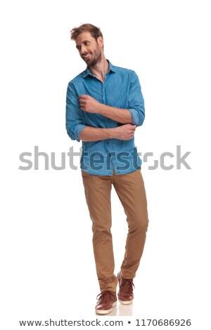 Oldalnézet fiatal divat férfi megjavít kabátujj Stock fotó © feedough