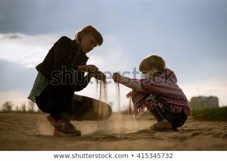 Enfants séance sable enfant été Voyage Photo stock © IS2