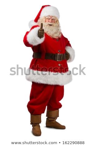 thumb up happy santa claus stock photo © studiostoks