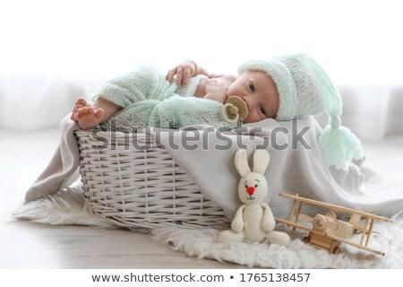 Little Cute Newborn Baby Lies on Small Green Rug Stock photo © robuart