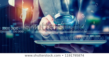 Businessman found a backdoor access on a tablet. Concept of internet security Stock photo © alphaspirit