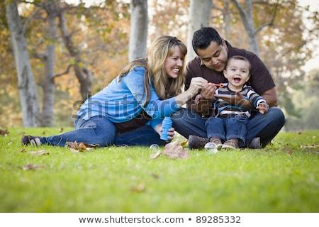 Boldog vonzó fiatal kaukázusi családi portré park Stock fotó © feverpitch