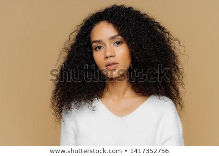 Portré töprengő nő sötét göndör haj visel Stock fotó © deandrobot