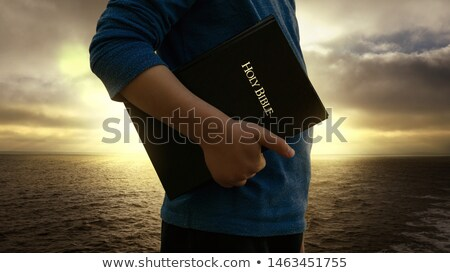 Young man holding book with wave Stock photo © ra2studio