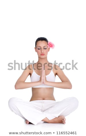 Young woman practicing yoga position in lotus flower, isolated o Stock photo © boggy