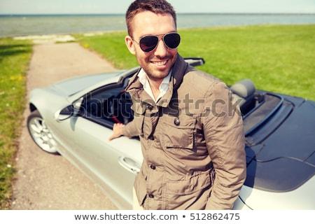 happy man near convertible car outdoors Stock photo © dolgachov
