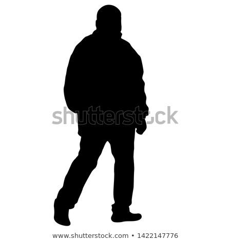 portrait of young elegant man standing with hands in pockets stock photo © feedough